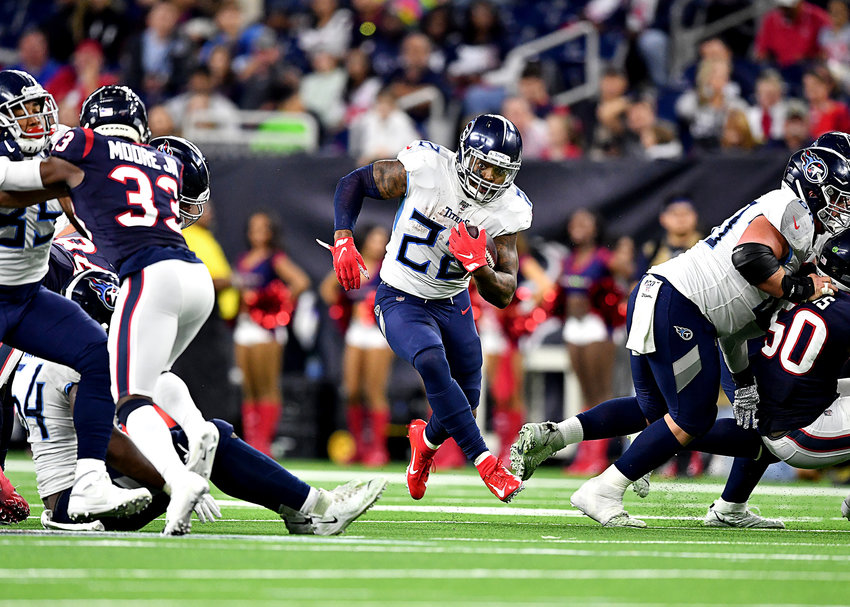 The Tennessee Titans offensive line makes a hole for running back Derrick Henry (22) during the second half of an NFL game against the Houston Texans Sunday, Dec. 29, 2019, at NRG Stadium in Houston Texas.