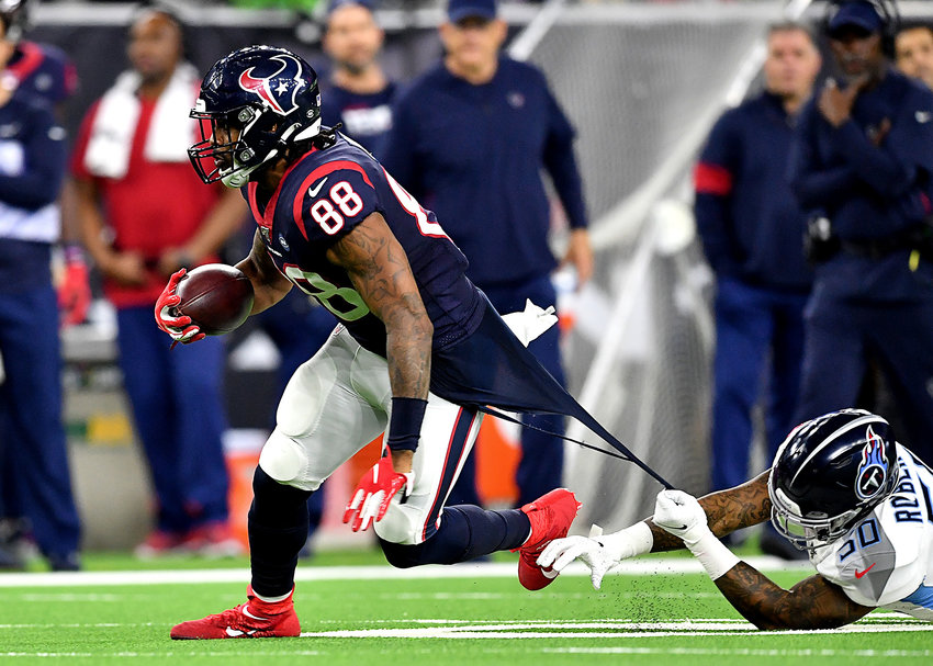Houston Texans tight end Jordan Akins (88) tries to escape the tenacious Tennessee Titans linebacker Derick Roberson (50) in the second half of an NFL game Sunday, Dec. 29, 2019, at NRG Stadium in Houston Texas.
