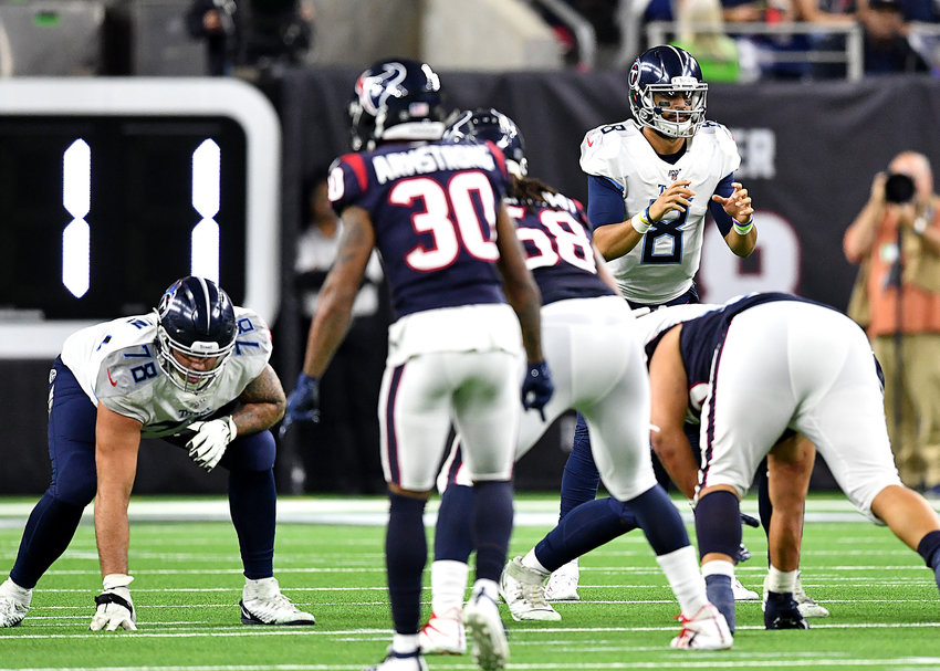 Tennessee Titans quarterback Marcus Mariota (8) back in action during the second half of an NFL game against the Houston Texans Sunday, Dec. 29, 2019, at NRG Stadium in Houston Texas.