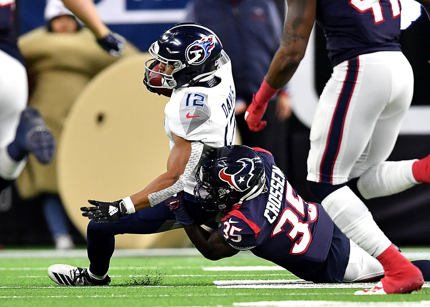 Tennessee Titans wide receiver Cameron Batson (12) is tackled by Houston Texans defensive back Keion Crossen (35) in the second half of an NFL game Sunday, Dec. 29, 2019, at NRG Stadium in Houston Texas.