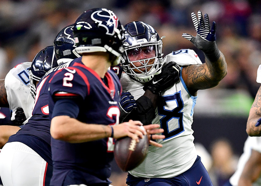 Tennessee Titans defensive tackle Jeffery Simmons (98) putting pressure on Houston Texans quarterback AJ McCarron (2) in the second half of an NFL game Sunday, Dec. 29, 2019, at NRG Stadium in Houston Texas.