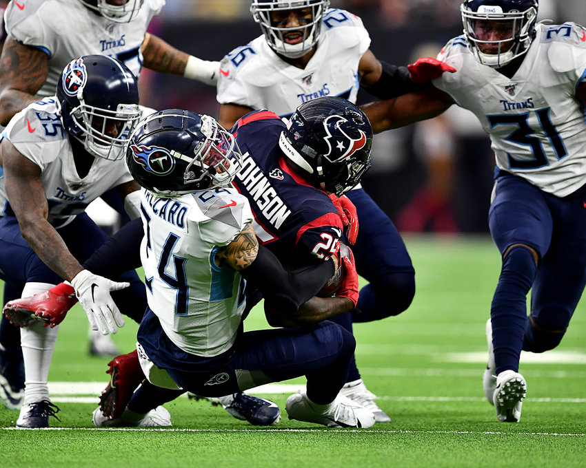 Tennessee Titans strong safety Kenny Vaccaro (24) and defensive back Tramaine Brock (35) lead their teammates in the coverage of Houston Texans running back Duke Johnson (25) in the first half of an NFL game Sunday, Dec. 29, 2019, at NRG Stadium in Houston Texas.