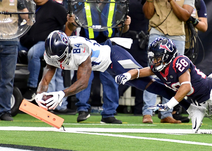 Tennessee Titans wide receiver Corey Davis (84) dives for the end zone in what appeared to be a touchdown, but was later reversed, in the first half of an NFL game against the Houston Texans Sunday, Dec. 29, 2019, at NRG Stadium in Houston Texas.