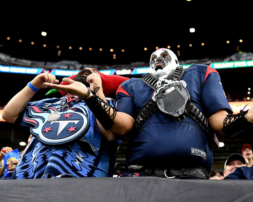 Fans in stands, during the first half of an NFL game between the Houston Texans and the Tennessee Titans Sunday, Dec. 29, 2019, at NRG Stadium in Houston, Texas.