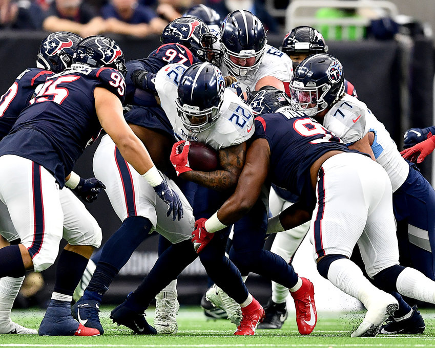 Tennessee Titans running back Derrick Henry (22) tries to push through a closing gap in the first half of an NFL game against the Houston Texans Sunday, Dec. 29, 2019, at NRG Stadium in Houston Texas.
