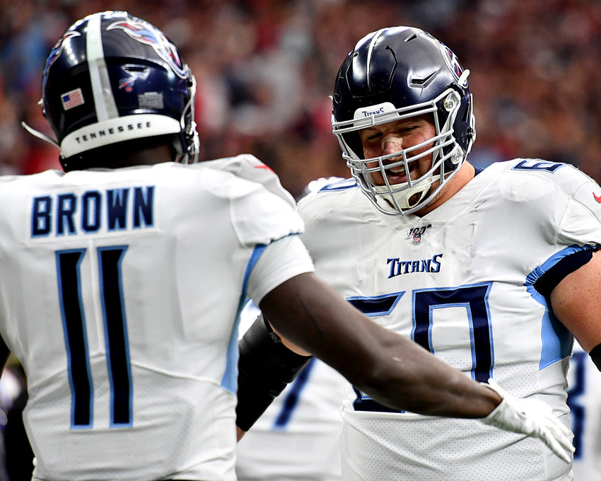 Tennessee Titans center Ben Jones (60) celebrates a touchdown with wide receiver A.J. Brown (11) in the first quarter of an NFL game against the Houston Texans Sunday, Dec. 29, 2019, at NRG Stadium in Houston Texas.