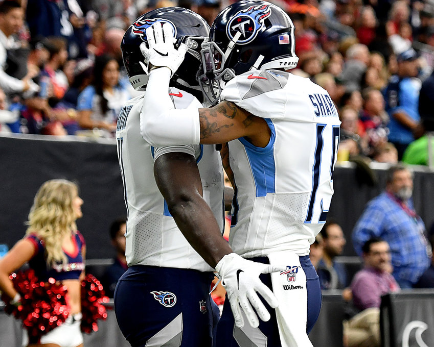 Tennessee Titans wide receiver Tajae Sharpe (19) celebrates a touchdown with wide receiver A.J. Brown (11) in the first quarter of an NFL game against the Houston Texans Sunday, Dec. 29, 2019, at NRG Stadium in Houston Texas.
