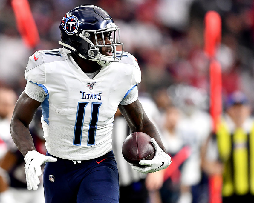 Tennessee Titans wide receiver A.J. Brown (11) makes the catch in stride and turns up the field on his way to a touchdown in the first quarter of an NFL game against the Houston Texans Sunday, Dec. 29, 2019, at NRG Stadium in Houston Texas.