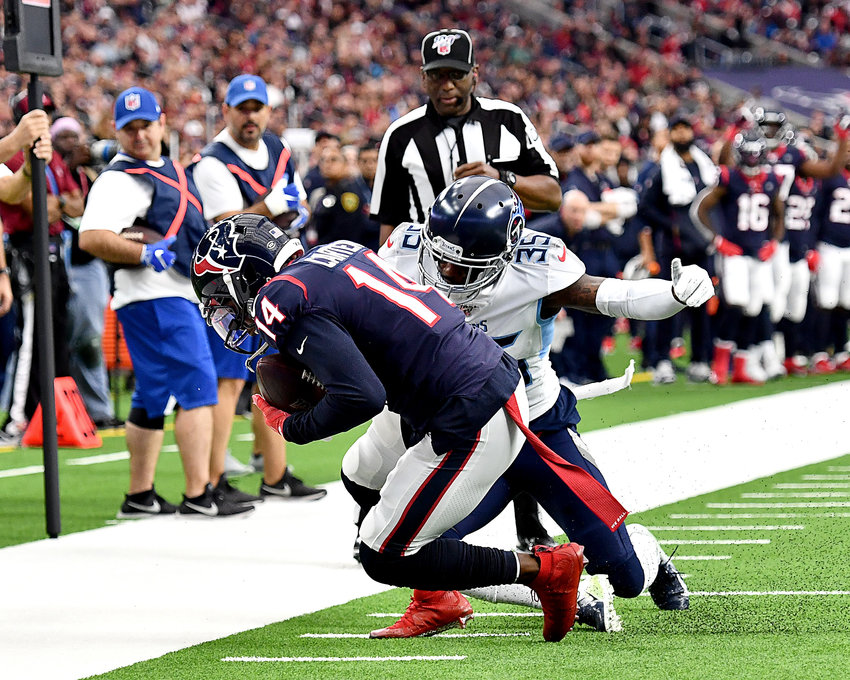 Tennessee Titans defensive back Tramaine Brock (35) tackles Houston Texans wide receiver DeAndre Carter (14) in the first half of an NFL game Sunday, Dec. 29, 2019, at NRG Stadium in Houston Texas.
