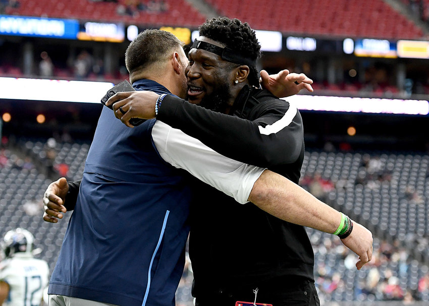 Tennessee Titans head coach Mike Vrabel greets former Tennessee Titans outside linebacker Brian Orakpo during the pregame warmup to an NFL game against the Houston Texans Sunday, Dec. 29, 2019, at NRG Stadium in Houston Texas.