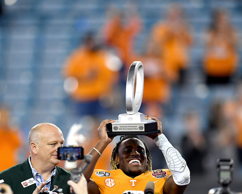 Tennessee Volunteers running back Eric Gray (3) holds up his MVP trophy from the Gator Bowl Thursday, January 2, 2020, at TIAA Bank Field in Jacksonville, Fla. The Volunteers beat the Indiana Hoosiers by one point, 22-23.