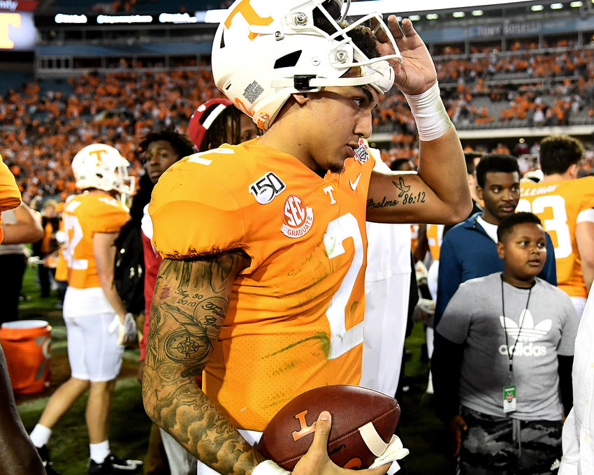 Tennessee Volunteers quarterback Jarrett Guarantano (2) carries the game ball following the Vols win over the Indiana Hoosiers in the Gator Bowl Thursday, January 2, 2020, at TIAA Bank Field in Jacksonville, Fla.