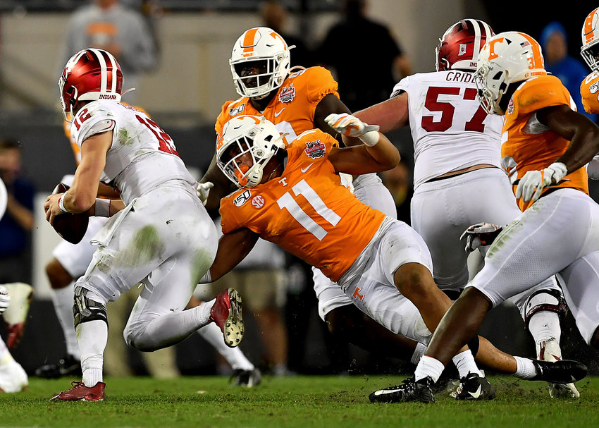 Tennessee Volunteers linebacker Henry To'o To'o (11) tries to get a hand on Indiana Hoosiers quarterback Peyton Ramsey (12) in the second half of the Gator Bowl NCAA football game Thursday, January 2, 2020, at TIAA Bank Field in Jacksonville, Fla.