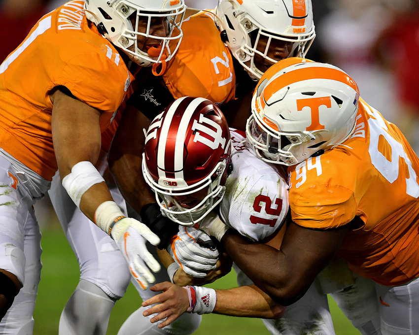 Indiana Hoosiers quarterback Peyton Ramsey (12) is sacked by Tennessee Volunteers defensive lineman Matthew Butler (94), linebacker Shanon Reid (21) and Tennessee linebacker Henry To'o To'o (11) in the first half of the Gator Bowl NCAA football game Thursday, January 2, 2020, at TIAA Bank Field in Jacksonville, Fla.