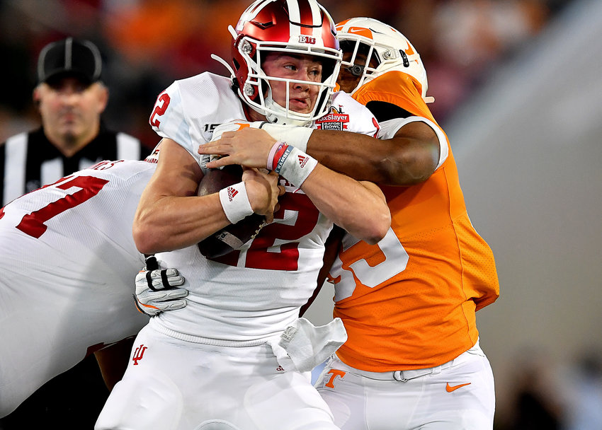Indiana Hoosiers quarterback Peyton Ramsey (12) prepares himself to be sacked in the first half of the Gator Bowl NCAA football game against the Tennessee Volunteers Thursday, January 2, 2020, at TIAA Bank Field in Jacksonville, Fla.