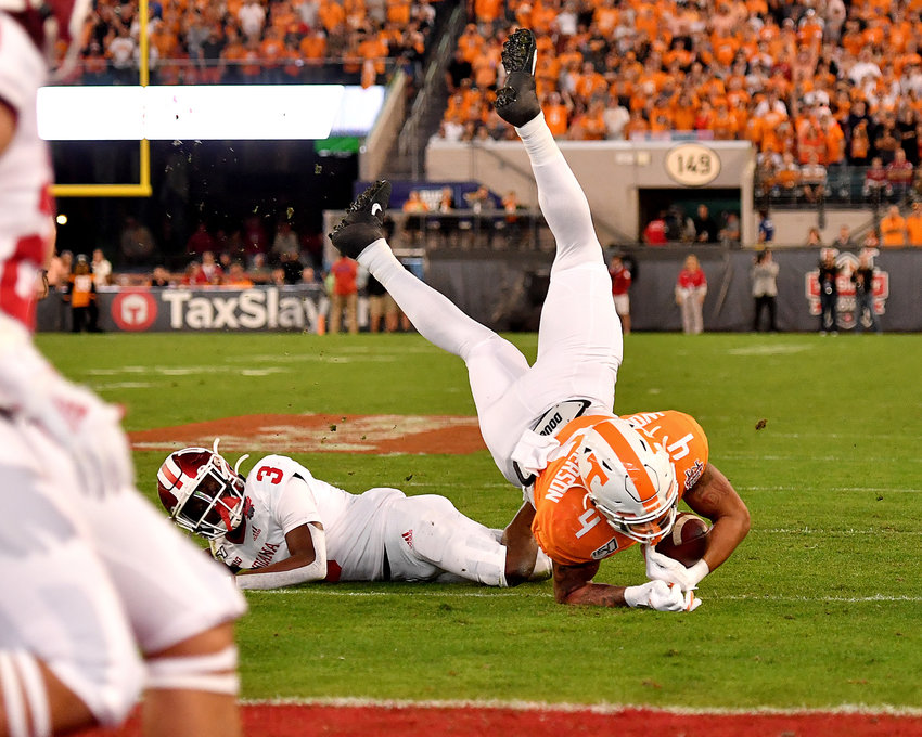 Tennessee Volunteers tight end Dominick Wood-Anderson (4) is upended after making a catch during the first half of the Gator Bowl NCAA football game against the Indiana Hoosiers Thursday, January 2, 2020, at TIAA Bank Field in Jacksonville, Fla.