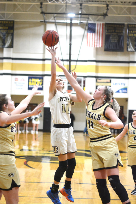 Upperman's Reagan Hurst, center, puts up a contested shot during the Lady Bees' 52-35 win over DeKalb County Tuesday night in Baxter.