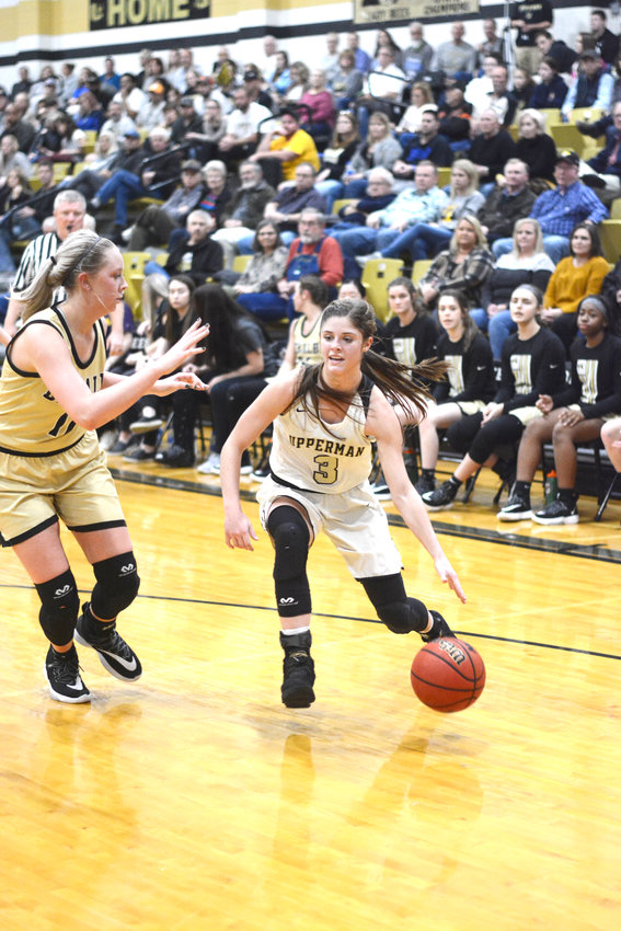 Upperman's Brooklyn Crouch, right, drives the lane during the Lady Bees' 52-35 win over DeKalb County Tuesday night in Baxter.