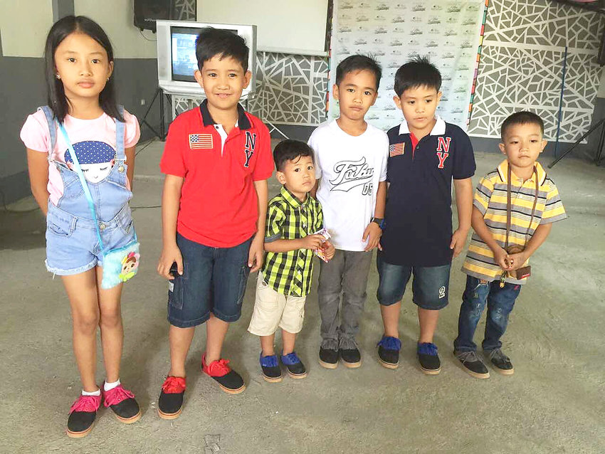 Filipino children show off the new shoes they received, thanks to the efforts of Cookeville couple Kenneth and Millet Hargis.