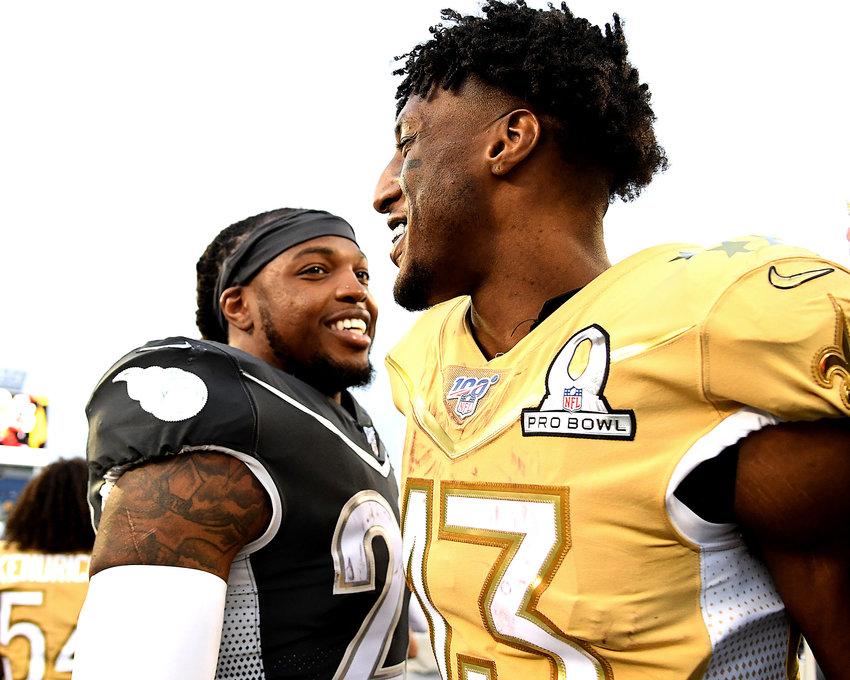 Tennessee Titans running back Derrick Henry (22) and New Orleans Saints wide receiver Michael Thomas (13) following the 2020 NFL Pro Bowl football game between the AFC and NFC, Sunday, Jan. 26, 2020, at Camping World Stadium in Orlando, Fla.