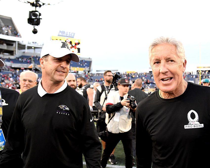 AFC head coach John Harbaugh and NFC head coach Pete Carroll leave the field following the 2020 NFL Pro Bowl football game between the AFC and NFC, Sunday, Jan. 26, 2020, at Camping World Stadium in Orlando, Fla.