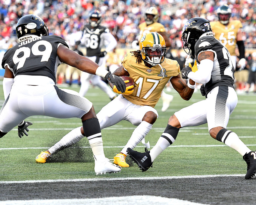 Green Bay Packers wide receiver Davante Adams (17) on his way to a touchdown in the second half of the 2020 NFL Pro Bowl football game between the AFC and NFC, Sunday, Jan. 26, 2020, at Camping World Stadium in Orlando, Fla.