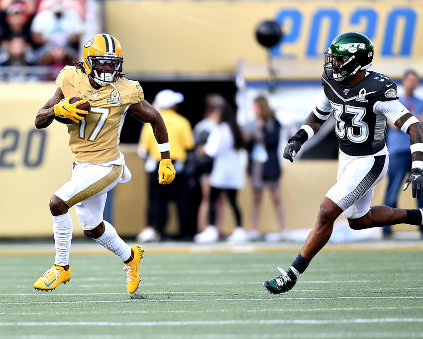 Green Bay Packers wide receiver Davante Adams (17) adds yards after the catch in the second half of the 2020 NFL Pro Bowl football game between the AFC and NFC, Sunday, Jan. 26, 2020, at Camping World Stadium in Orlando, Fla.