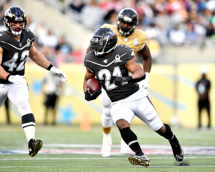 Baltimore Ravens running back Mark Ingram Jr. (21) finds room to run during the second half of the 2020 NFL Pro Bowl football game between the AFC and NFC, Sunday, Jan. 26, 2020, at Camping World Stadium in Orlando, Fla.