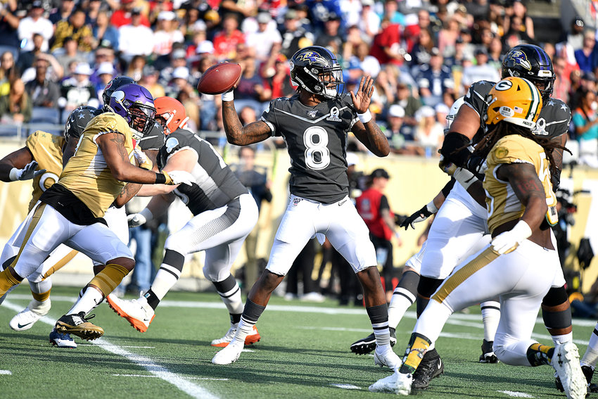 Baltimore Ravens quarterback Lamar Jackson (8) in the pocket looking for a receiver during the first half of the 2020 NFL Pro Bowl football game between the AFC and NFC, Sunday, Jan. 26, 2020, at Camping World Stadium in Orlando, Fla.