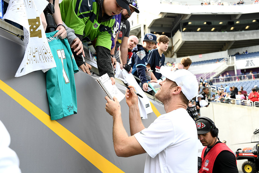 Tennessee Titans quarterback Ryan Tannehill (17) signs autographs prior to the 2020 NFL Pro Bowl football game between the AFC and NFC, Sunday, Jan. 26, 2020, at Camping World Stadium in Orlando, Fla.