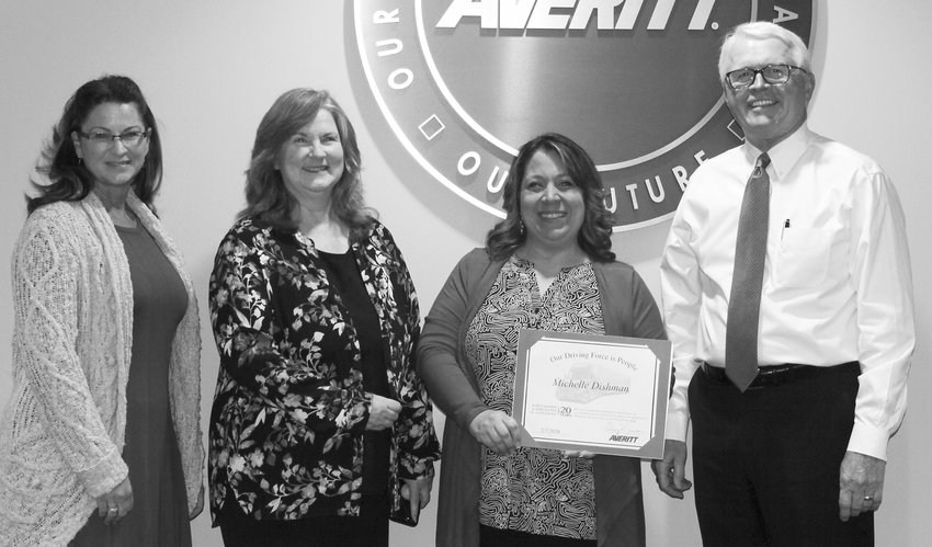 Michelle Dishman, second from right, is welcomed to the Averitt Over 20 Team by, from left, director of invoicing collections and cash Marilyn Hyden, invoicing leader Karen Waller and Averitt president and chief operating officer Wayne Spain.