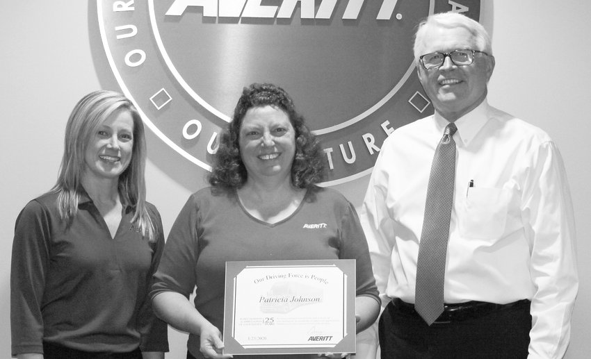 Patty Johnson, center, receives her 25-year service award from Averitt traffic leader Beth Powers,  left, and president and chief operating officer Wayne Spain.