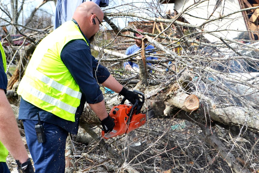 Volunteer Terry Cronk was one of hundreds of volunteers wielding chainsaws to help clear debris from this week's tornado.
