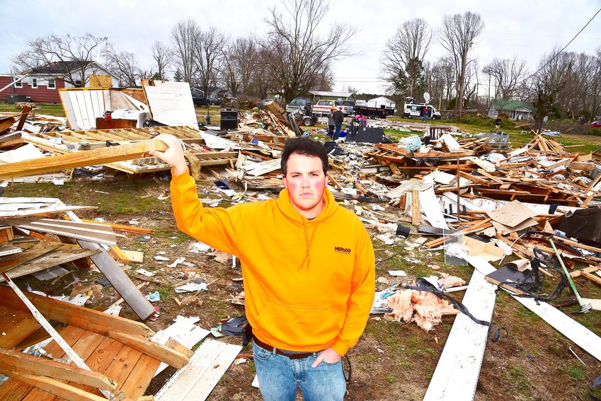 Matt Mifflin stands in the rubble of what used to be his hous on McBroom Chapel Road.