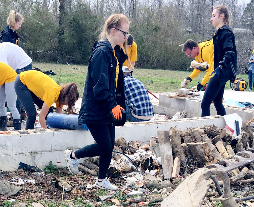 Members of the Tech soccer team were among several TTU sports teams that volunteered community service Wednesday in the local community.