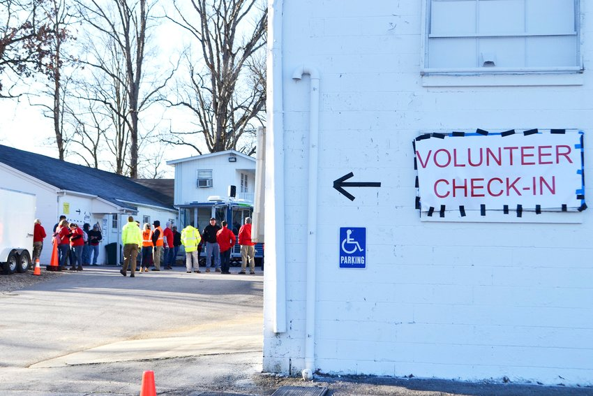 A sign at the Putnam County Fairgrounds directs volunteers to a check-in site.