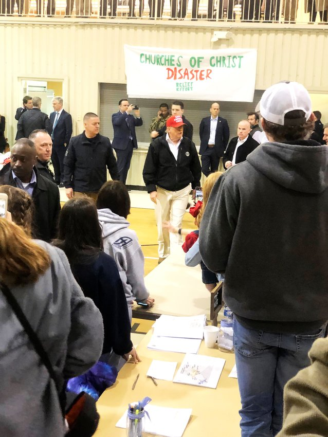 President Donald Trump, in a red Keep America Great hat, greets the crowd at the Churches of Christ Disaster Relief center at Jefferson Avenue Church of Christ in Cookeville Friday.
