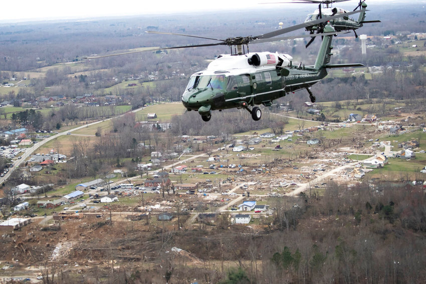 Marine One, with President Donald Trump aboard, flies over damage after a recent tornado, Friday, March 6, 2020, taken on the plane in flight over Cookeville, Tenn. (AP Photo/Alex Brandon).