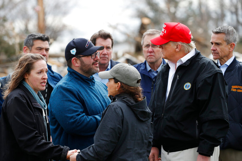 President Donald Trump, accompanied by Tennessee First Lady Maria Lee, center,  speaks with residents Matt and Angela Suggs as they tour damage from a recent tornado, Friday, March 6, 2020, in Cookeville, Tenn.  (AP Photo/Alex Brandon)