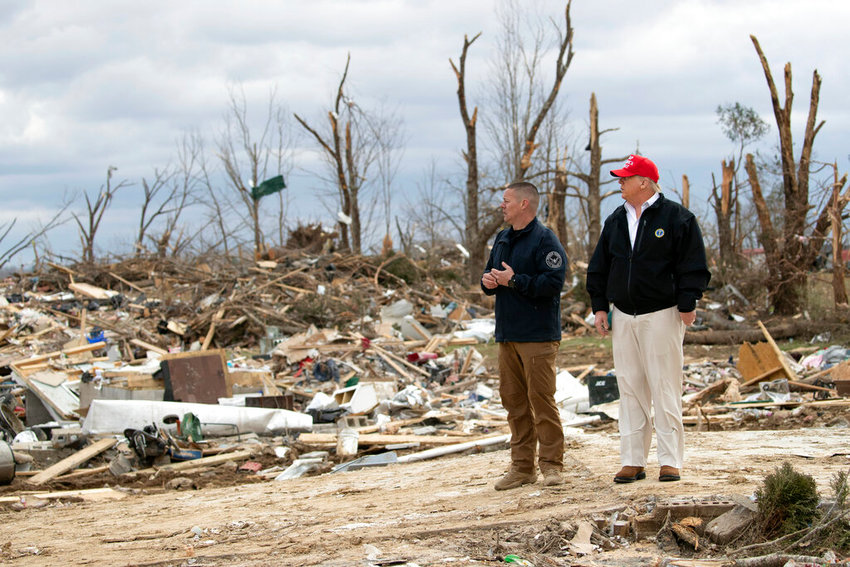 President Donald Trump speaks Mike Herrick, with Putnam County Rescue Squad, as he tours damage from a recent tornado, Friday, March 6, 2020, in Cookeville, Tenn.  (AP Photo/Alex Brandon)