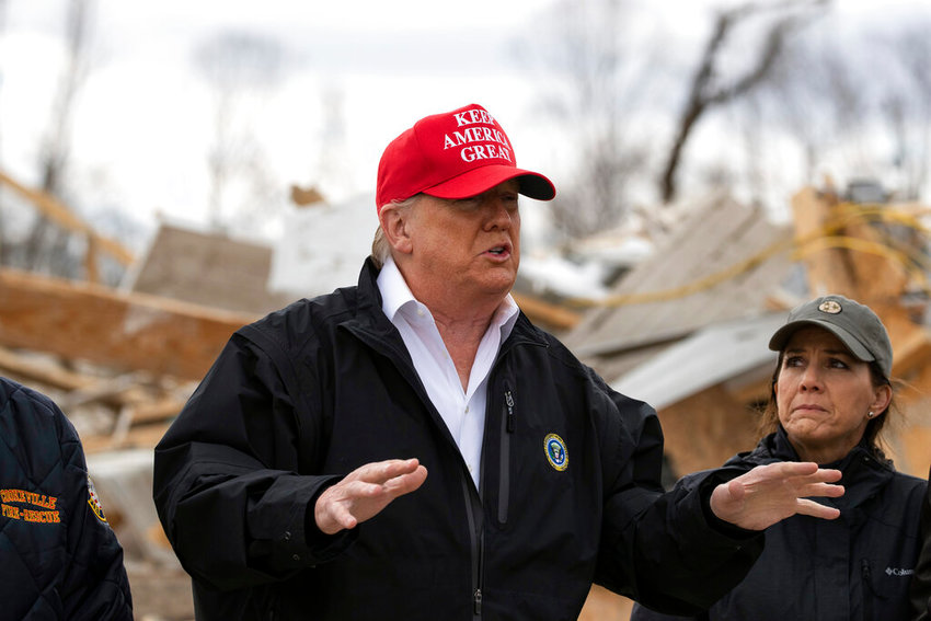President Donald Trump speaks, accompanied by Maria Lee, wife of Gov. Bill Lee, as they tour damage from a recent tornado, Friday, March 6, 2020, in Cookeville, Tenn.  (AP Photo/Alex Brandon)