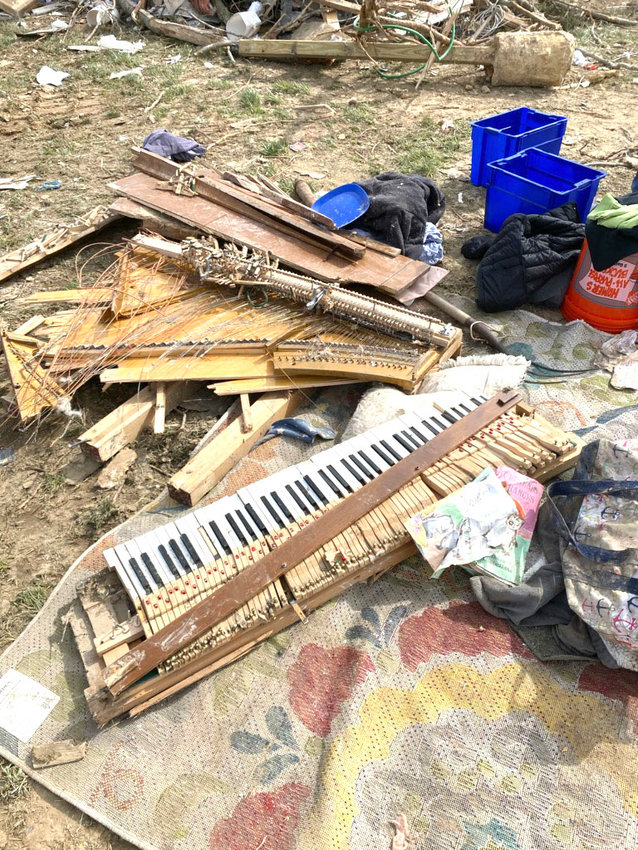 The pieces of Jill Mynatt's grandmother's antique piano lay in shards in the remnants of the Mynatts' property Monday morning, a week after the tornado struck the neighborhood off North McBroom Chapel and killed nine people in the neighborhood.