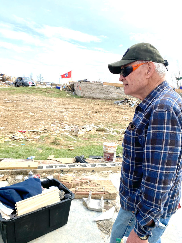 Chester Bush, 'The Major,' as he's known in his neighborhood on Hensley Drive, talks about sifting through the rubble left of his home last week demolished by the tornado. Bush, an Army veteran, was in California when the tornado struck his home.