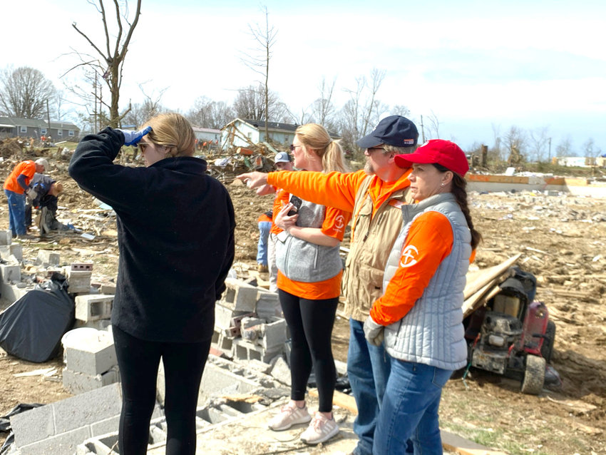 Tennessee First Lady Maria Lee, right, talks with Samaritan's Purse Site Manager and other staff about instructions for cleanup Monday on Hensley Drive.
