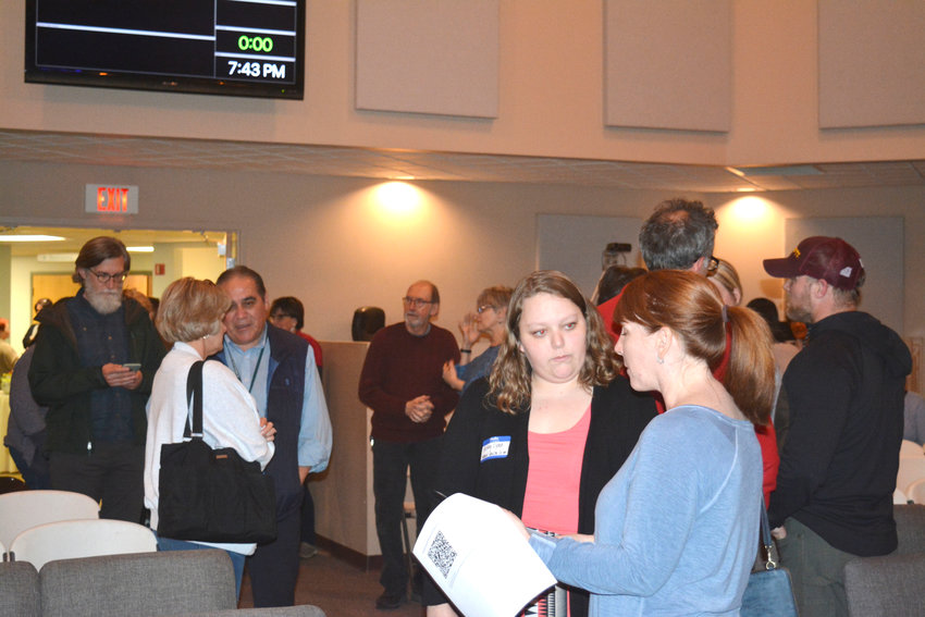 The audience breaks after Dr. John Averitt speaks during the Community Debriefing Wednesday.