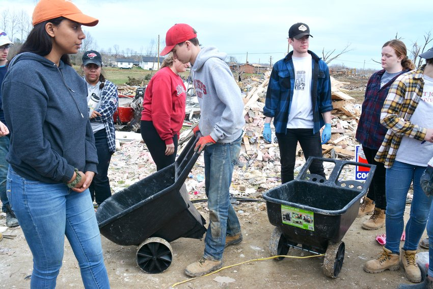 Students from St. Joseph's University in Philadelphia are visiting Putnam County helping clean debris from tornados and offer support to the community.