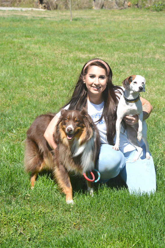 Haley Hunter with a client's dog, Nelson, and her small dog, Bentley.