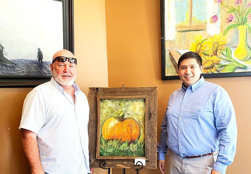 Blaine Parrish, left, is  Putnam 1st Mercantile Bank and Cookeville Art Studio and Gallery artist of the month. During the month of October, Parrish's work will be on display at the bank's main branch on West Jackson Street. He is joined by Matthew Furcean, one of the bank's customer service representatives.