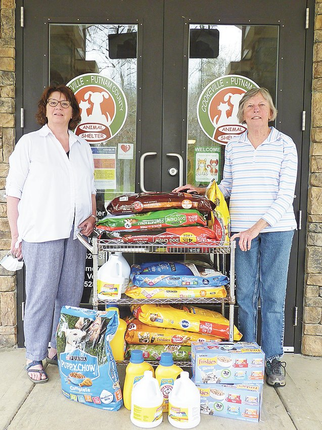 Friendship United Methodist Church members donated dog and cat food and cleaning supplies to the Putnam County Animal Shelter. From left, are members Shelly Kinnaird and Rosemary Allen at the shelter.