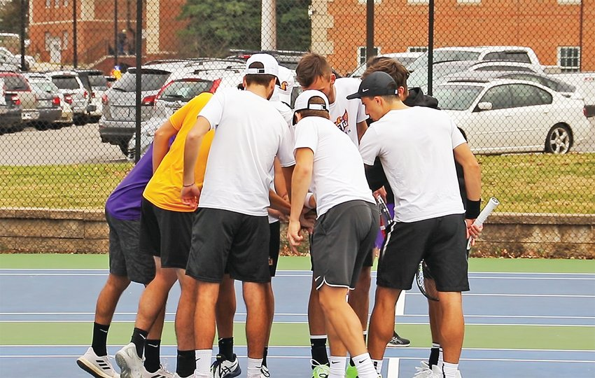 The Tennessee Tech tennis team talks strategy in the huddle.